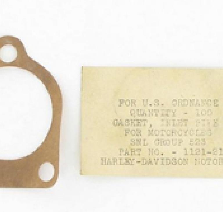 #1121-21 Pakning, manifold/karburator .0...